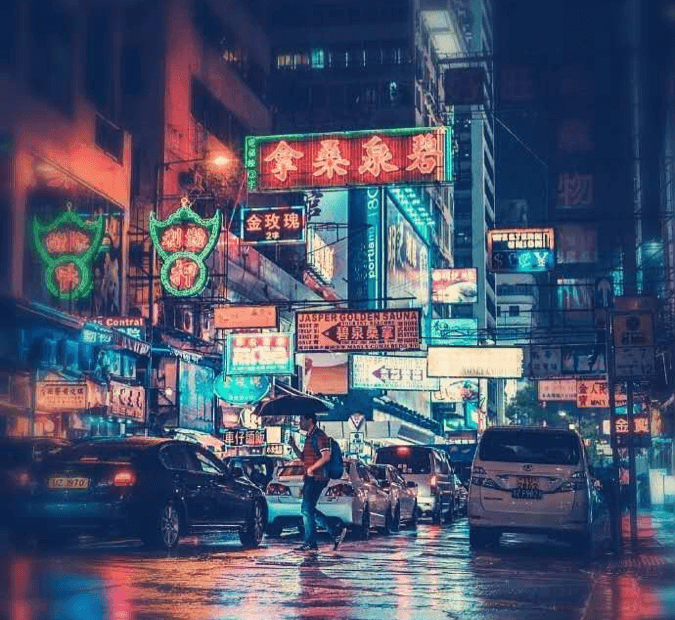 Beautiful and nostalgic neon light signs in a rainy night on a street in Mong Kok, Hong Kong